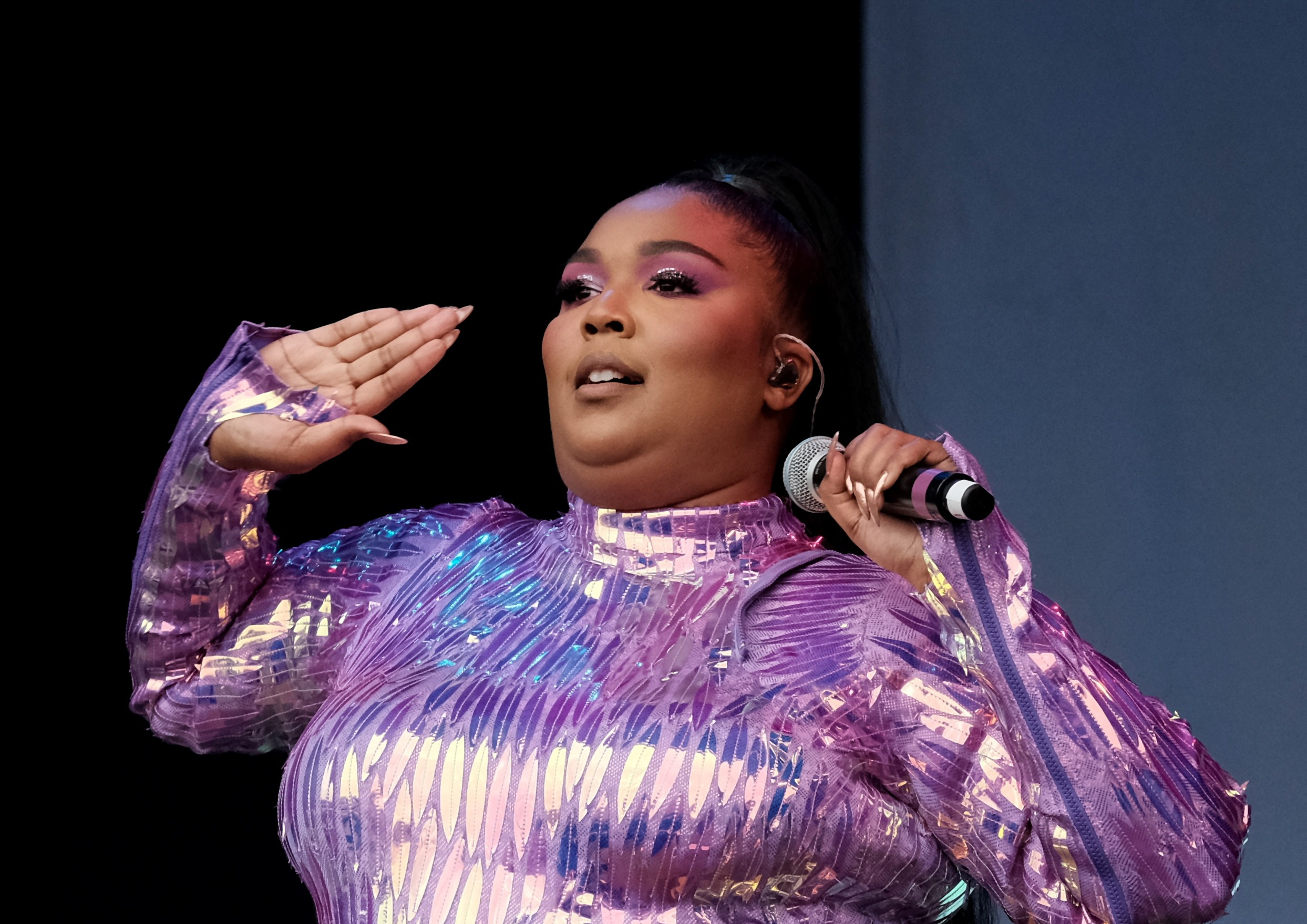 EXCLUSIVE: Lizzo Wants Postmates Driver To Pay Her Legal Bill