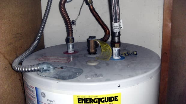 Top of water heater, showing hot and cold water, relief water pipe and electrical plate