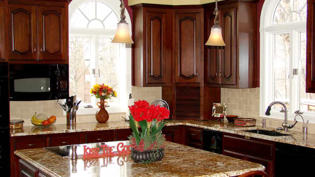 Flowers add a lot of personality to a kitchen.  Also shows mounted microwave and corner cubby to hide unsightly appliances.