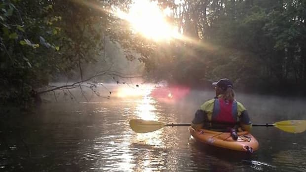 Author Kayaking on a Sunrise Paddle on the Rogue River
