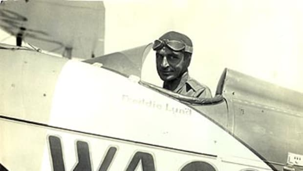 Freddie Lund in his Waco biplane as test pilot for the company.