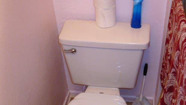 repairing-a-broken-pipe-in-the-bathroom