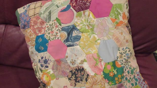family-history-in-an-object-patchwork-cushion-of-family-fabrics-and-furnishings-for-the-famous