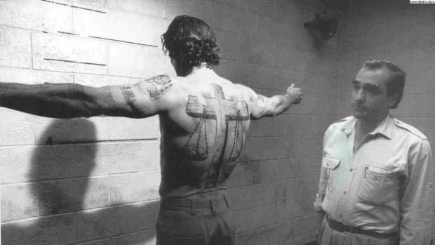 DeNiro's character, convict-out-for-revenge Max Cady, was covered in tattoos, many of which taken from Biblical imagery.  Scales of justice were rendered as a cross-themed full-back tattoo with multiple Bible quote tattoos on the chest and arms.