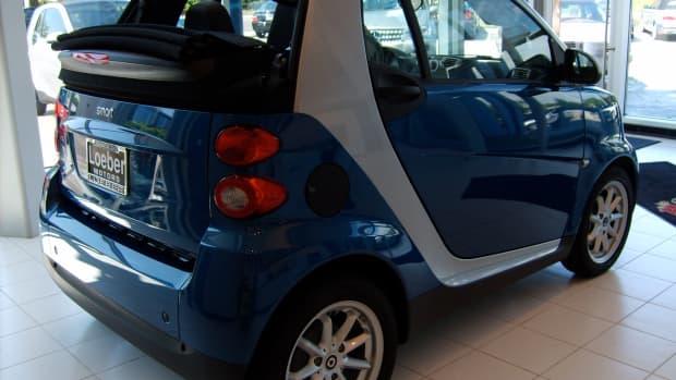Dealer's blue Smart Car Side View