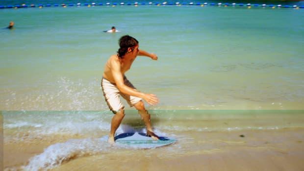 Beach skimboarding in Okinawa Japan