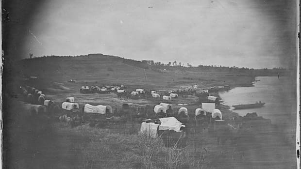 Oklahoma Attracted settlers from all over.  This picture shows a wagon train heading towards Oklahoma Territory.