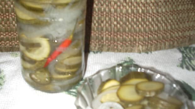 A jar of sliced zucchini with sweet onions and hot pepper