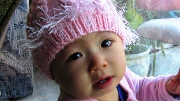 how-to-knit-a-baby-hat-with-double-pointed-needles-pink-cabled-baby-hat-free-knitting-pattern