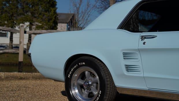 a-streak-of-a-pale-blue-car