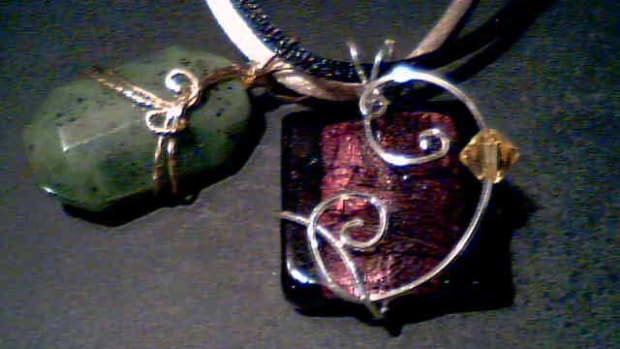 Dichroic glass with swarovski crystal in sterling silver, and faceted jade pendant in 14k gold
