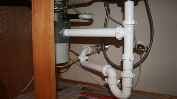 Pipes Under the Kitchen Sink (Photo courtesy by scttrknndy from Flickr)