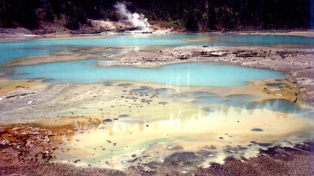 Colorful pools of water with steam rising