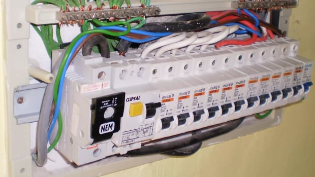 A house electrical panel with the cover removed.