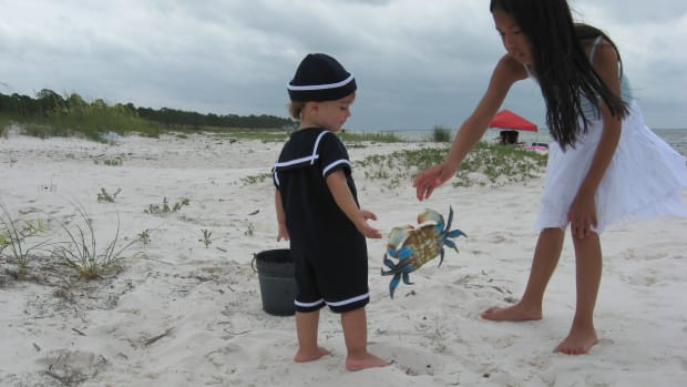 My grandson, Tristan, and niece, Madison, on a crabbing expedition. I've told them about playing with their food!