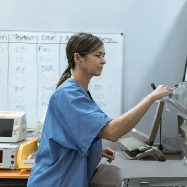 Female nurse looking at some files