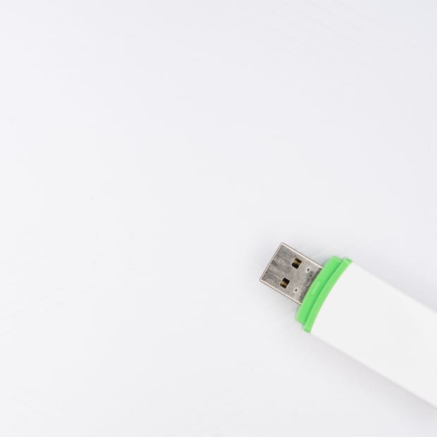 a single USB storage device with a white background