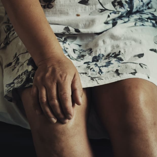 Person with their hand on their knee
