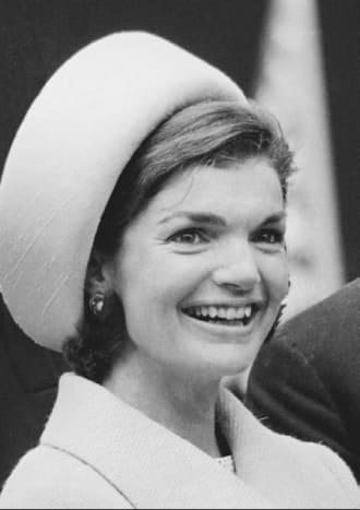Jackie Kennedy in her trademark pillbox hat.