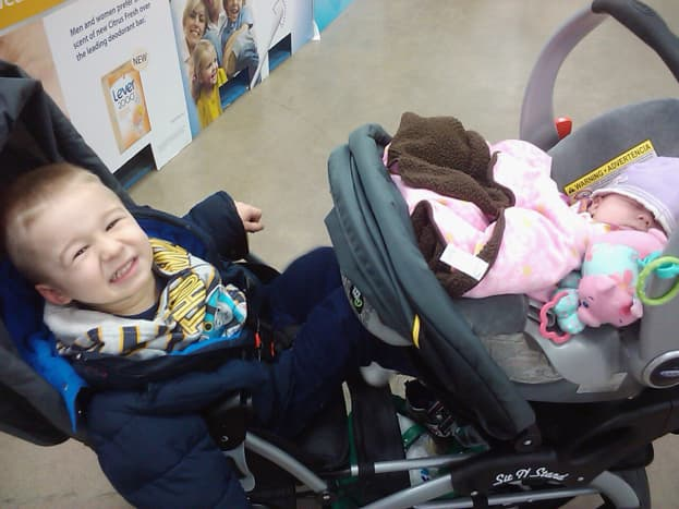 My son and daughter in the Sit-n-Stand during a long shopping trip.