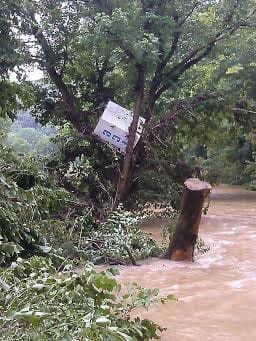 This is days after the initial flooding that devastated West Virginia. My low-water crossing is way below the water level. You can imagine the force behind that water that managed to push a commercial Ice dispenser from miles away into that tree.