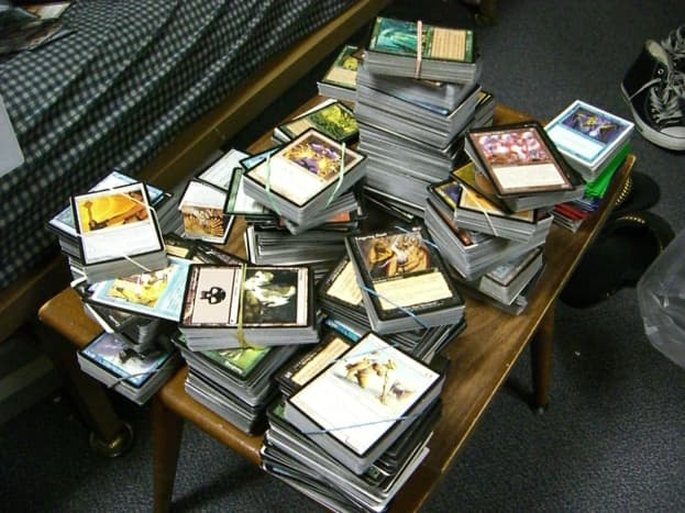 A large stack of cards, separated into decks.
