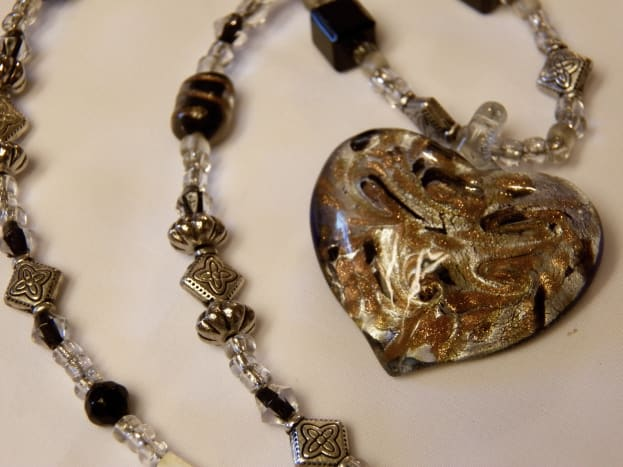 Necklace with heart pendant on stretch string.