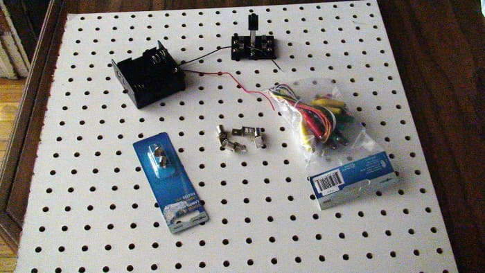Materials required to create a simple circuit board to investigate basic current electricity.