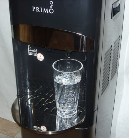 The Primo water dispenser, dispensing cold water.