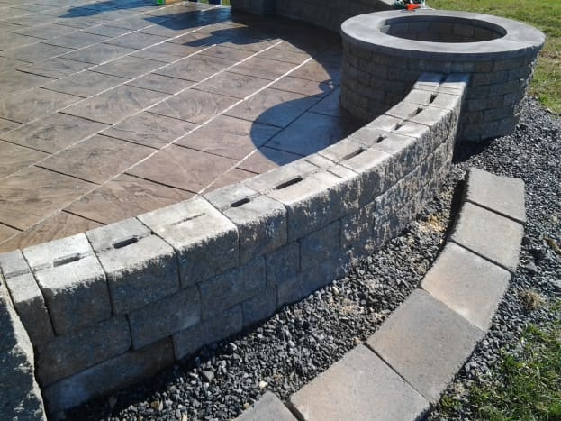 Fire pit situated in an existing masonry wall