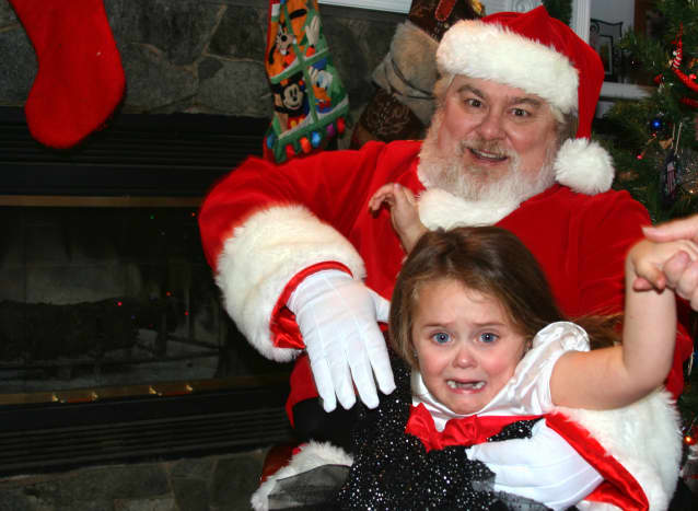 """""""Ho, Ho, Ho"""" or """"No, No, NO!"""" ... ?  This little girl is scared of Santa."""