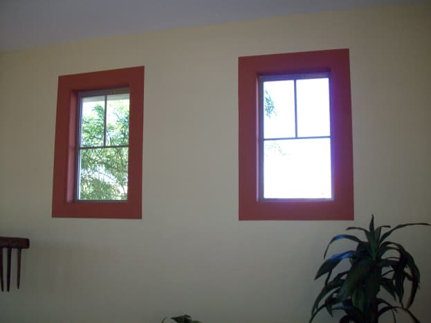 These windows are highlighted with a dark red border which eliminates the need for a traditional window treatment.
