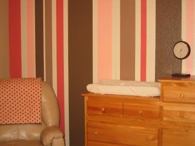 Different shades of pink and brown are combined to create this striped wall. Photo courtesy of bentleyteam.blogspot.com