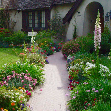 English Country Cottage—typified by a cluster of brightly colored, contrasting flowers of different heights mass-planted together.