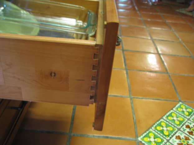RTA tongue and grove box is deep and has with wood sides and bottom. Shelves and drawers are 1/2 inch solid wood.  Drawers soft close and  like the doors are full-face.