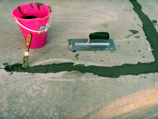 Simple tools used; a small spatula, a child's beach bucket and a concrete trowel.