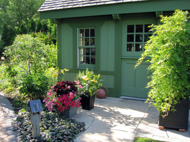 This quaint cottage provides a beautiful storage and work space for the test garden.