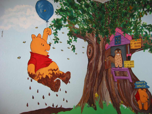 Pooh pretending to be a cloud.  My wall mural ideas came from children's book illustrations.