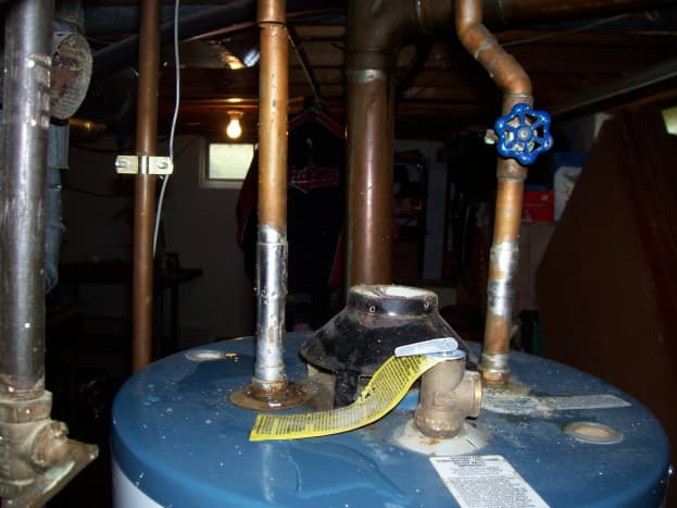 Here you can see the set up I started with. I will cut the cold side just a couple inches below the valve. You can also see that my T & P valve was on top.
