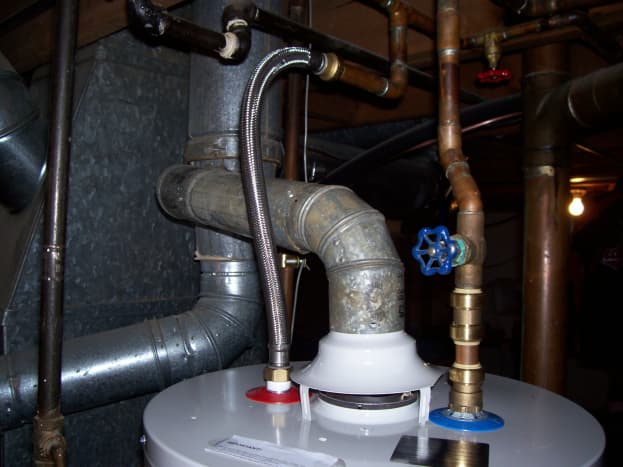 Here is the finished product on the top side. You can see where my new plumbing hooks into my old plumbing and the products and fittings I chose to use. This photo sums up a lot of this article. Notice I was able to reuse the same flue parts.