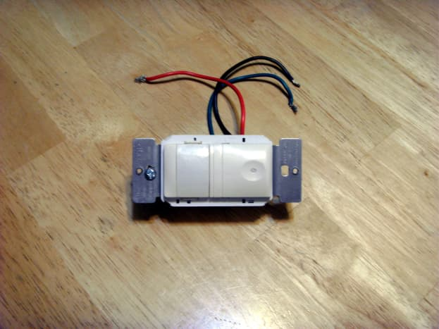 A common motion sensor switch.  Black, red and green wires with no neutral wire required.