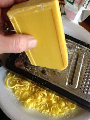 Grate the bar soap into slithers so it will melt faster and easier on the stove.