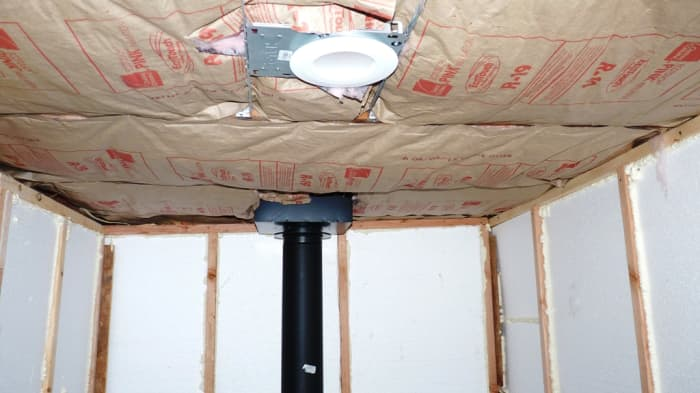I added paper-backed fiberglass insulation to the ceiling.