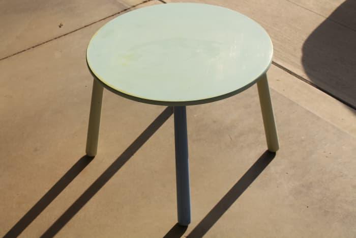 Multi-colored garage sale table.