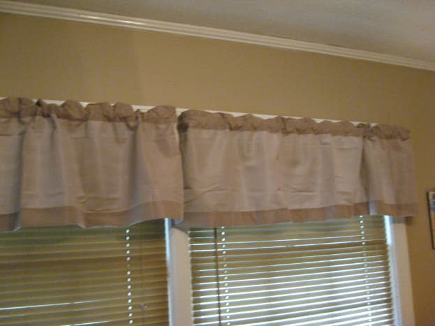 Use curtains that are about the same shade as the walls.