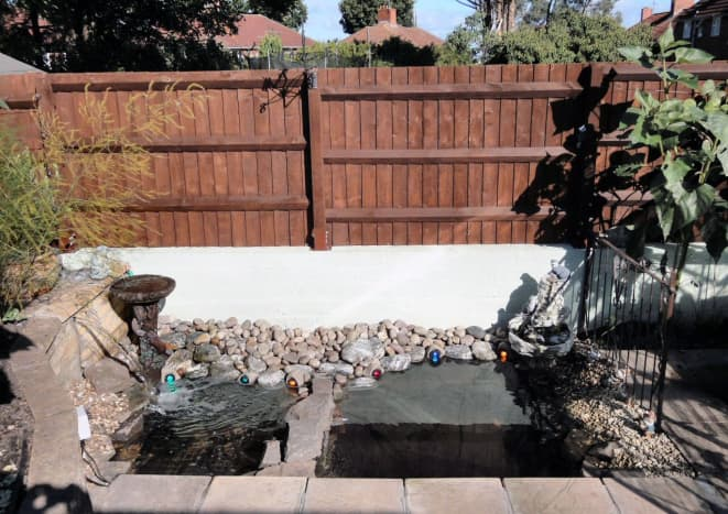 Out pond c2010, with water features and halogen lighting.