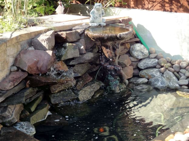 Natural stones to create waterfall as a new water feature, c2011.
