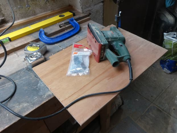 Cutting side panel to size to divide cupboard