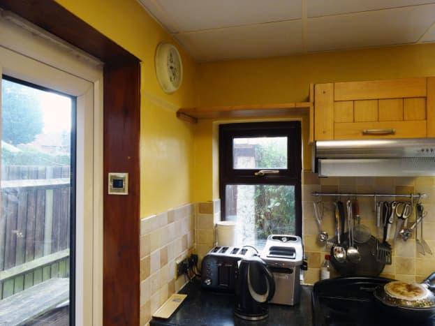 Shelf above small kitchen window lowered.
