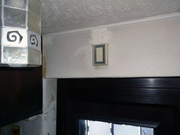 Doorbell chimes with the bell wire concealed in the wall and hidden in the D-Line mini trunking running discreetly along the top of the wall